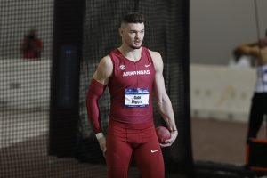 Moore Paces Hogs On Day One