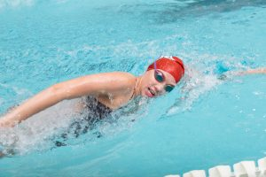 Swim Sets Four Records, Schultz Takes Second