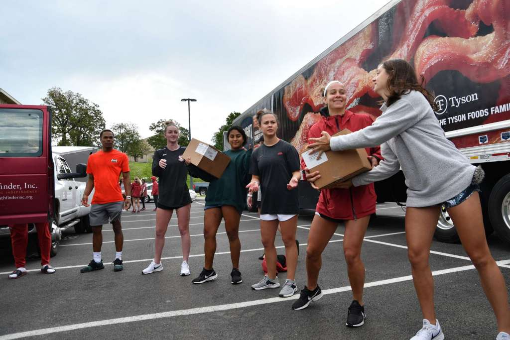 University of Arkansas, Tyson Foods & Ambassadors of Compassion Team Up to Feed the Hungry in Northwest Arkansas